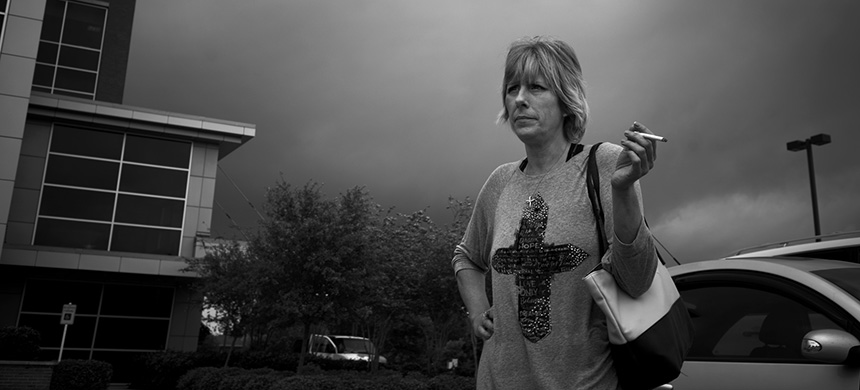 Albritton, then a 41-year-old mother of two boys, was strip searched at the Harris County Jail in 2010. 'Oh, yes, with the bend over, cough,' she recalled. (photo: Todd Heisler/NYT)