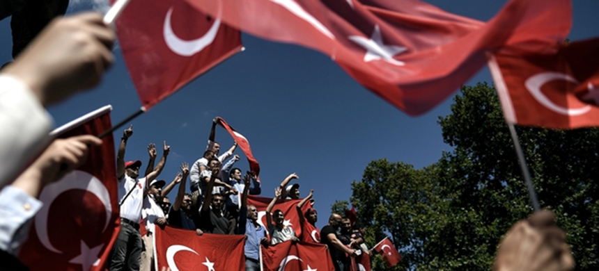 Pro-Erdogan supporters hold Turkish flags during a protest at the Sarachane park in Istanbul. (photo: AFP)