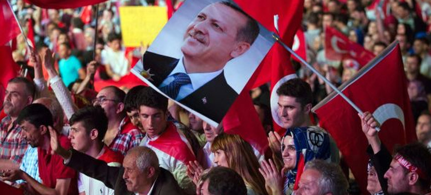 Turkish president Erdogan's supporters wave Turkish flags and a picture of his face at a rally in the aftermath of the failed coup attempt in Istanbul, July 19, 2016. (photo: Petros Giannakouris/AP)