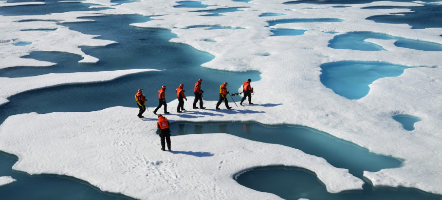 Researchers check ice floe thickness. (photo: Colorado.edu)