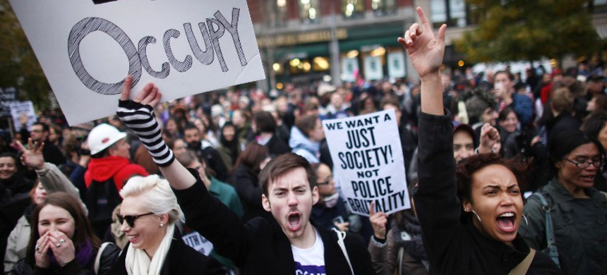 Protesters rally to call attention to wealth inequality and police brutality. (photo: Getty Images)