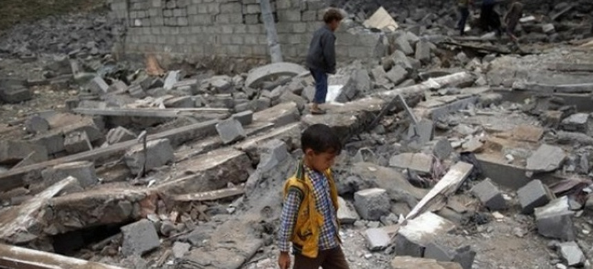 A boy walks on rubble of a house after it was destroyed by a Saudi-led air strike in Yemen's capital Sanaa. (photo: Reuters)