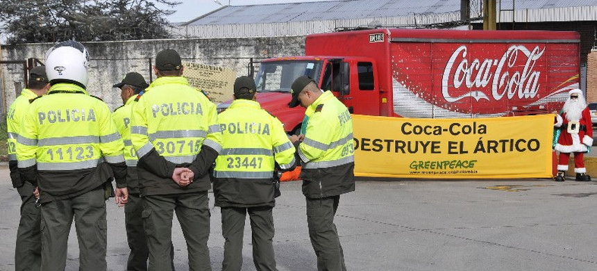 Police gather near a protest against Coca-Cola in Columbia. (photo: GreenPeace)