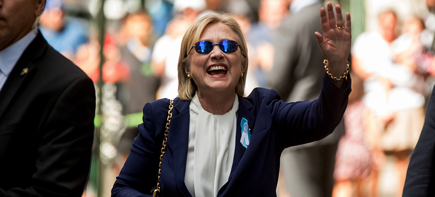 Democratic presidential candidate Hillary Clinton waves after leaving an apartment building Sunday, Sept. 11, 2016, in New York. (photo: Andrew Harnik/AP)