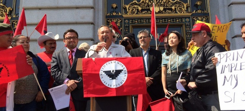 UFW President Arturo Rodriguez, backed by members of the San Francisco Board of Supervisors, addresses the crowd on the City Hall steps on the anniversary of Cesar Chavez' birthday. (photo: Hannah Albarazi/Bay City New)