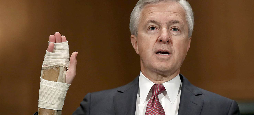 John Stumpf, chairman and CEO of the Wells Fargo Company, is sworn in prior to testifying before the Senate Banking, Housing and Urban Affairs Committee on Sept. 20 in Washington. (photo: Win McNamee/Getty Images)