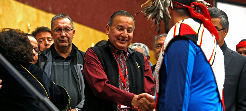 Grand Chief Stewart Phillip shakes the hands of First Nation leaders after they sign the Treaty Alliance Against Tar Sands Expansion during an announcement on oil sands pipelines Thursday at the Musqueam Community Centre in Vancouver, British Columbia. (photo: Ben Nelms/Reuters)