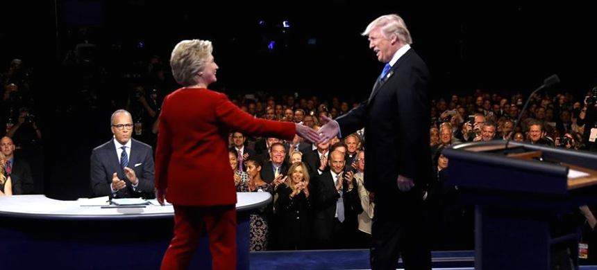 Republican U.S. presidential nominee Donald Trump shakes hands with Democratic U.S. presidential nominee Hillary Clinton at Hofstra University in Hempstead, New York, Monday, September 26, 2016. (photo: TIME)