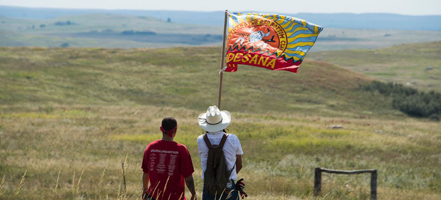 Native American protestors wave a clan flag over land designated for the Dakota Access Pipeline near Cannon Ball, North Dakota, September 3, 2016. (photo: Robyn Beck/AFP/Getty Images)
