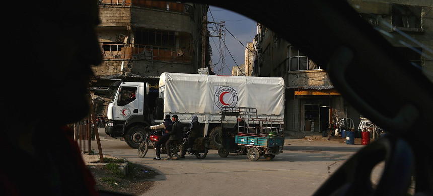 A Syrian Red Crescent truck, part of a convoy carrying humanitarian aid, is seen in Kafr Batna on the outskirts of Damascus on Feb. 23, 2016, during an operation in cooperation with the U.N. to deliver aid to thousands of besieged Syrians. (photo: Abd Doumany/Getty)