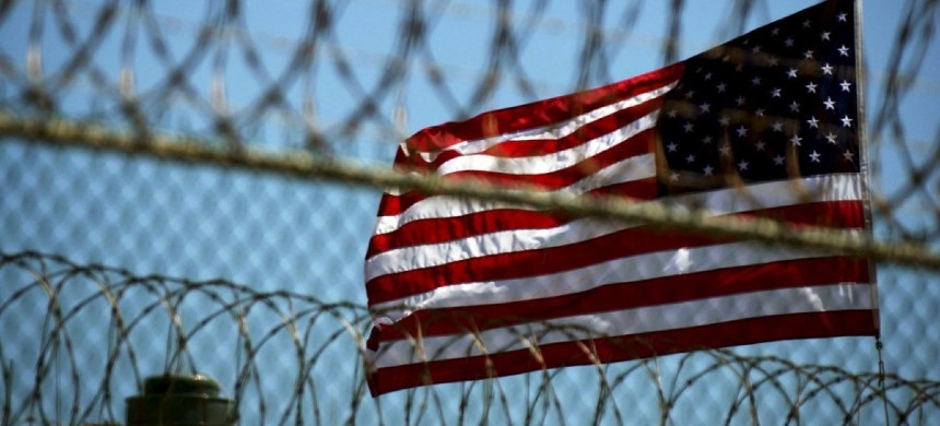 American flag seen through fence at a prison. (photo: EPA)