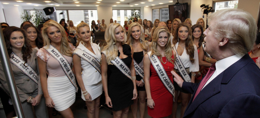 Donald Trump addresses Miss USA contestants in a conference room in Trump Tower, during their to New York, Wednesday, May 25, 2011. (photo: Richard Drew/AP)