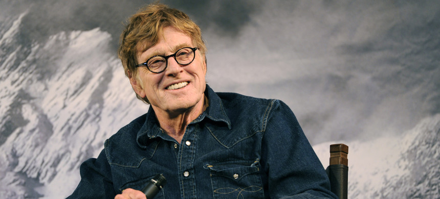 Robert Redford, founder of the Sundance Institute, interacts with the media during the opening day press conference at the 2015 Sundance Film Festival in Park City, Utah. (photo: Chris Pizzello/Invision/AP)