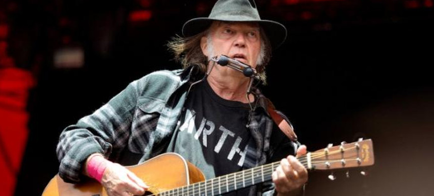 Canadian singer-songwriter Neil Young performs at the Orange Stage at the Roskilde Festival in Roskilde, Denmark, July 1, 2016. (photo: Nils Meilvang/Reuters)