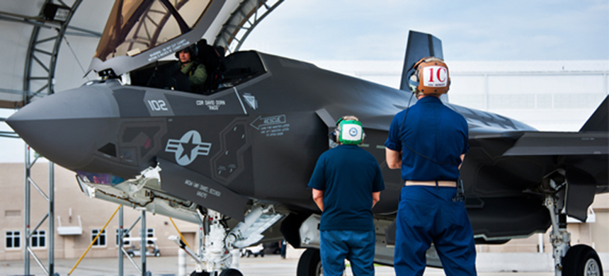Navy maintainers stand by a grounded F-35. (photo: U.S. Air Force)