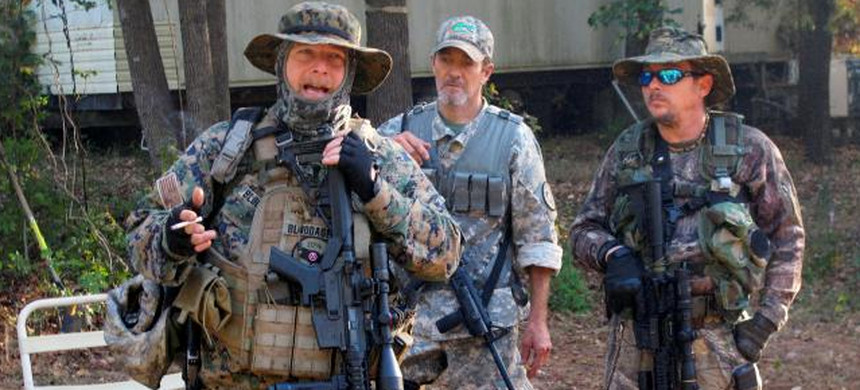 Chris Hill (L), the leader of the Georgia Chapter of the III% Security Force militia, speaks to members during a field training exercise in Jackson, Georgia, U.S. October 29, 2016. (photo: Justin Mitchell/Reuters)