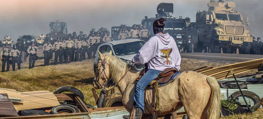 The water protectors holding their ground, fearless. (photo: Standing Rock Rising/Facebook)