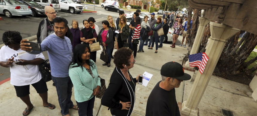 Various counties have collectively reduced the number of polling locations available to voters by at least 16 percent - eliminating more than 860 places. (photo: Reed Saxon/AP)