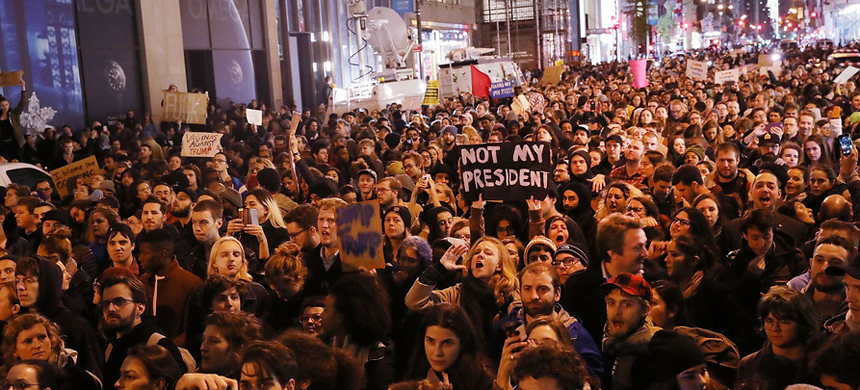 Thousands of anti-Donald Trump protesters shut down 5th Avenue in front of Trump Tower as New Yorkers react to the election of Trump as president of the United States, November 9, 2016. (photo: Spencer Platt/Getty)