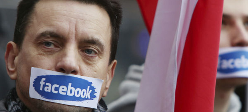 Should Facebook censor fake news? (photo: Czarek Sokolowski/AP)