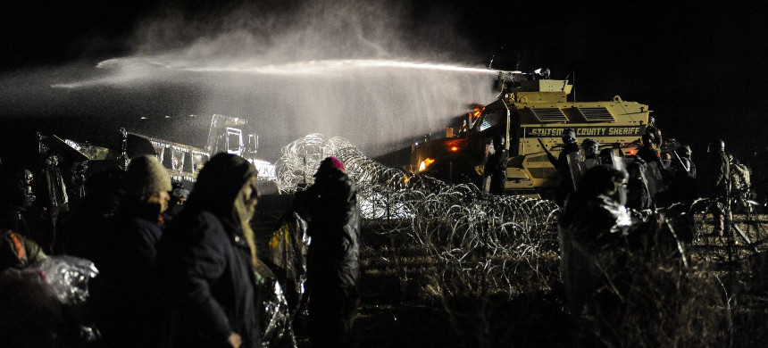 Police use a water cannon on Standing Rock protesters on Monday November 21, 2016. (photo: Stephanie Keith/Reuters)