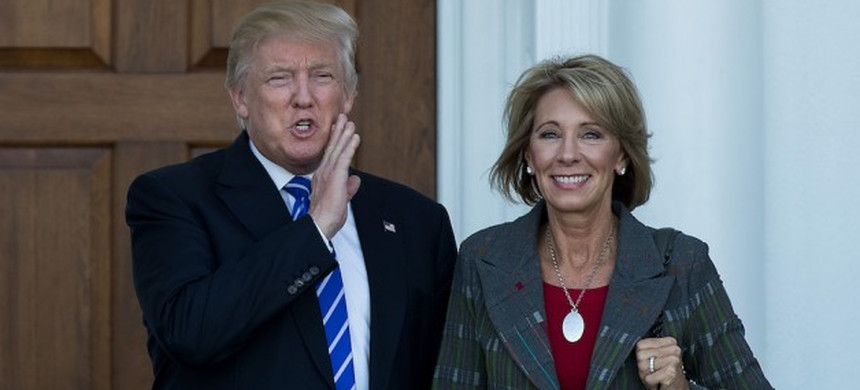 President-elect Donald Trump and Department of Education head Nancy DeVos. (photo: Getty)