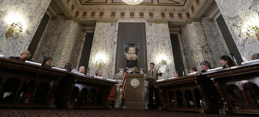 Members of Washington state's Electoral College are instructed on the paperwork in casting their votes December 17, 2012, in Olympia, Washington. (photo: Elaine Thompson/AP)