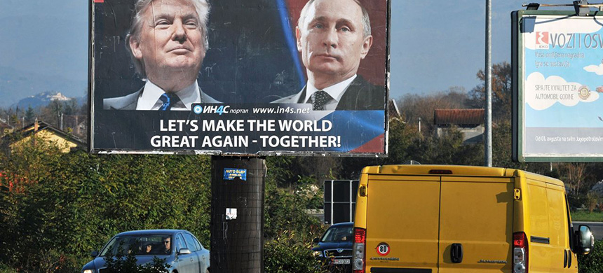 Cars pass by a billboard showing US President-elect Donald Trump and Russian President Vladimir Putin placed by pro-Serbian movement in the town of Danilovgrad on Nov. 16, 2016. (photo: Savo Prelevic/AFP/Getty Images)