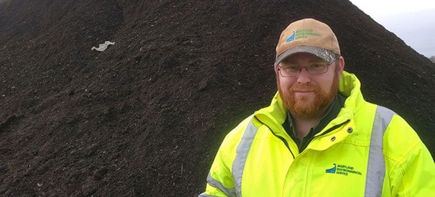 Steven Birchfield, supervisor of food composting operations at Prince George's County's compost facility in Upper Marlboro, Md., holds a handful of compost in front of a pile that's ready to sell on December 16, 2016. (photo: Lonnie Shekhtman)