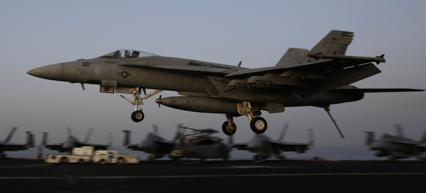U.S. jet lands on an aircraft carrier. (photo: U.S. Navy)