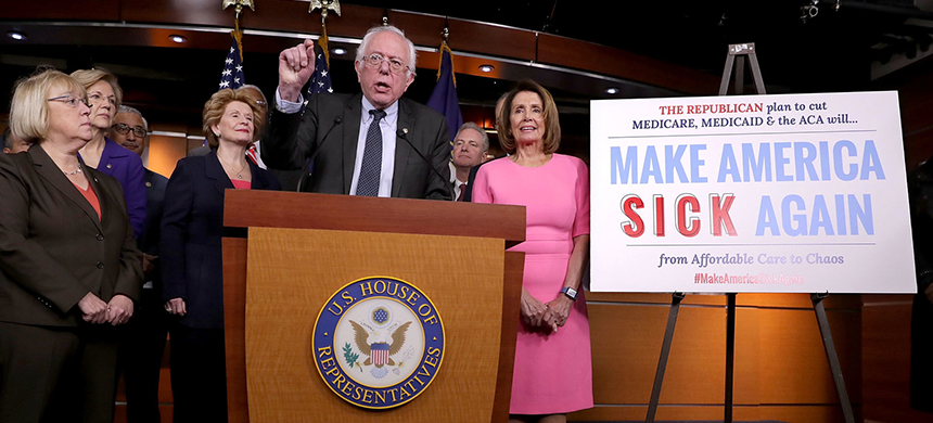 Sen. Bernie Sanders talks to reporters about preserving the Affordable Care Act with fellow Democrats from both the House and Senate after a meeting with President Obama at the U.S. Capitol on Wednesday in Washington, D.C. (photo: Chip Somodevilla/Getty Images)