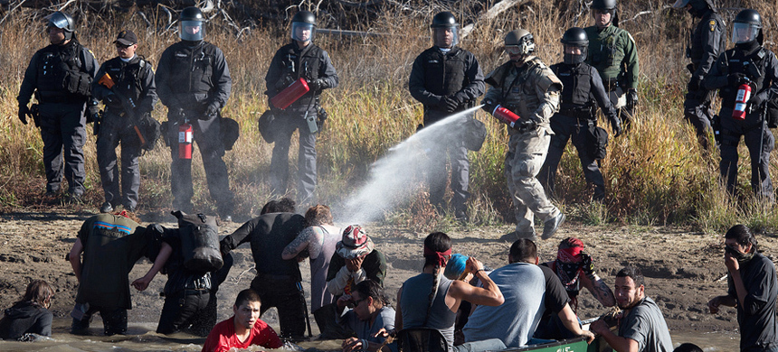 Police use pepper spray against protesters trying to cross a stream near an oil pipeline construction site near Standing Rock Indian Reservation, north of Cannon Ball, North Dakota, November 2, 2016. (photo: Jason Patinkin/Reuters)