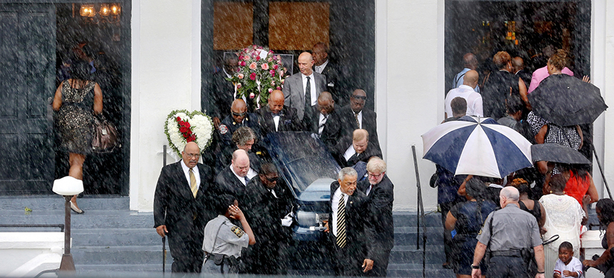 Rain falls as pallbearers exit Emanuel AME Church carrying the casket of Cynthia Hurd on June 27, 2015, in Charleston, S.C. (photo: Grace Beahm/The Post and Courier/AP)