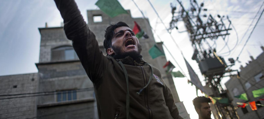 A Palestinian chants slogans during a demonstration against the chronic power cuts in Jabaliya refugee camp, Northern Gaza Strip, Thursday, January 12, 2017. Thousands of people took to the streets on Thursday to protest chronic power cuts in the Hamas-ruled Gaza Strip. (photo: Khalil Hamra/AP)