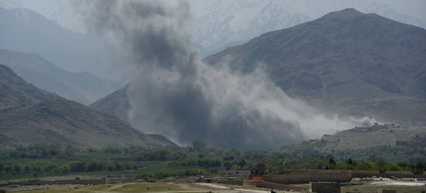 Smoke rises from the mountains following an airstrike in Achin district, where the U.S. deployed its largest non-nuclear bomb used in combat on Thursday. (photo: Noorullah Shirzada/Getty)