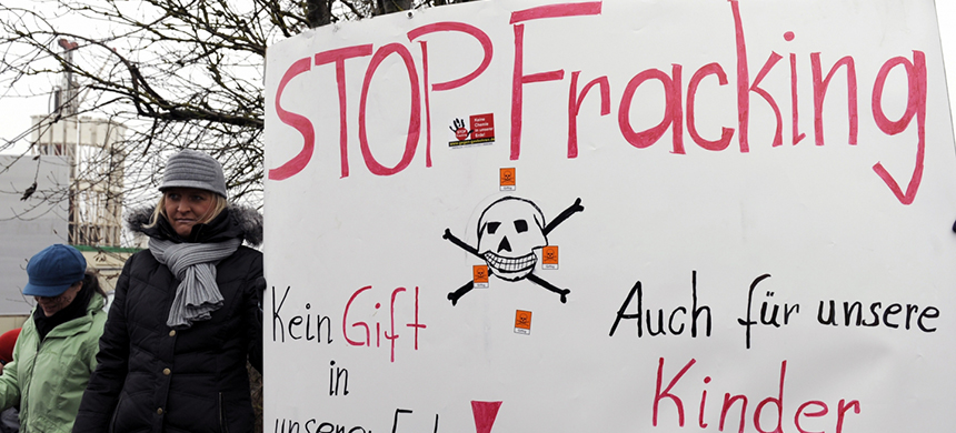 Protesters hold a placard with the words 'Stop Fracking' during a demonstration near Langeneck, Germany, in February 2011. (photo: David Hecker/dapd/AP)