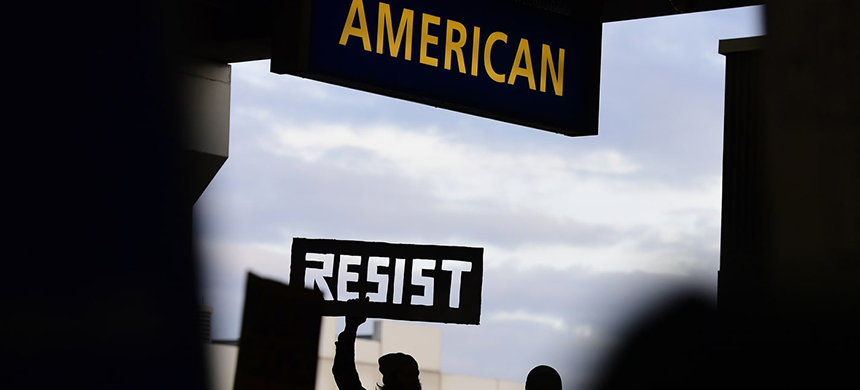 Protester at Philadelphia International Airport in Philadelphia holds up a cutout sign during a protest of President Donald Trump's executive order banning travel to the U.S. by citizens of Iraq, Syria, Iran, Sudan, Libya, Somalia or Yemen, Sunday, January 29th, 2017. (photo: Corey Perrine/AP)