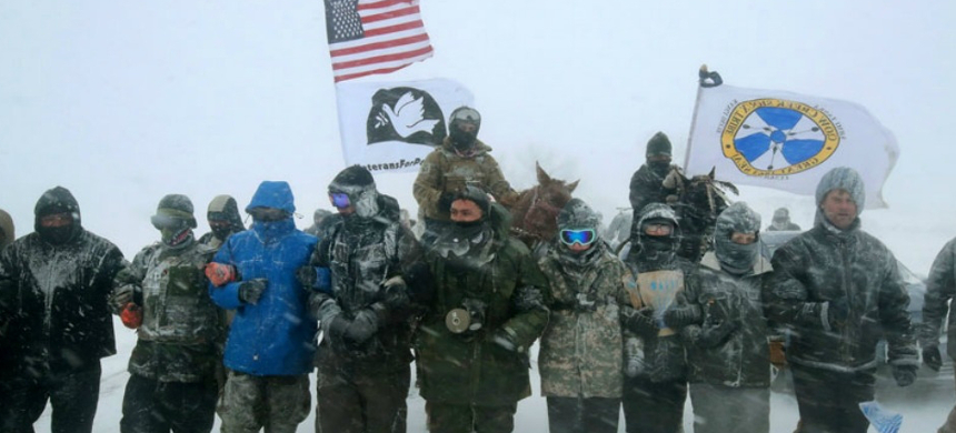 Veterans link arms during a prayer action at Standing Rock on Monday. (photo: Scott Olson/Getty)