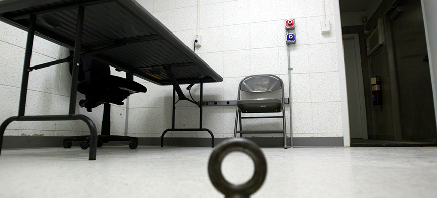 An interrogation room in Camp Delta for detainees from the U.S. war in Afghanistan is shown April 7, 2004 in Guantanamo Bay, Cuba. (photo: Joe Raedle/Getty Images)