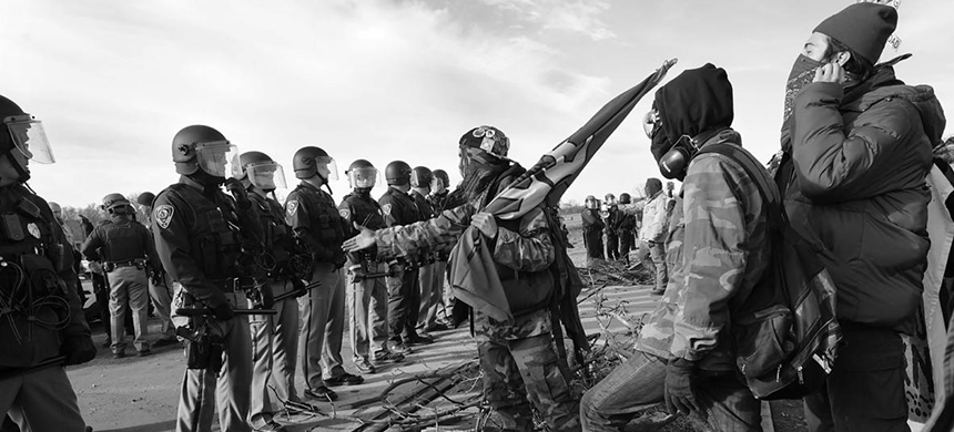 By ordering construction of the Dakota Access Pipeline to resume, the President is participating in one of this country's oldest traditions - repressing Native Americans. (photo: Larry Towell/Magnum)
