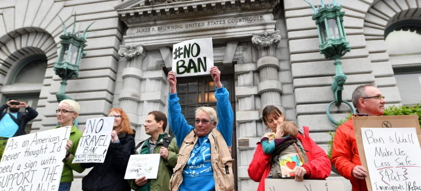 Protesters stand in front of the United States Court of Appeals for the Ninth Circuit in San Francisco, California, February 7, 2017. (photo: Getty Images)