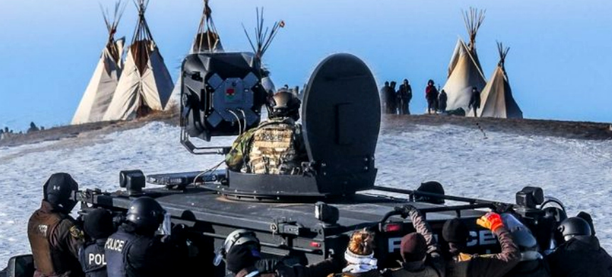 Police at the edge of a Standing Rock protest encampment near Cannon Ball, North Dakota. (photo: Counter Current News)