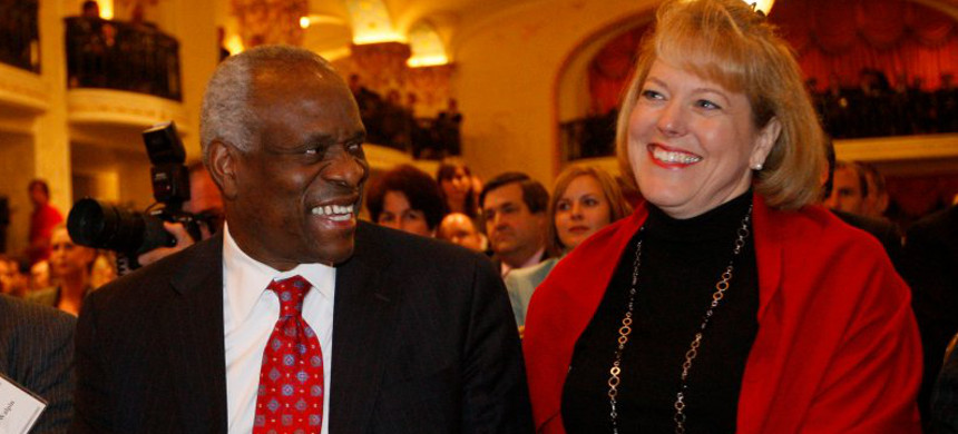Supreme Court Justice Clarence Thomas and his wife Ginni. (photo: Charles Dharapak/AP)