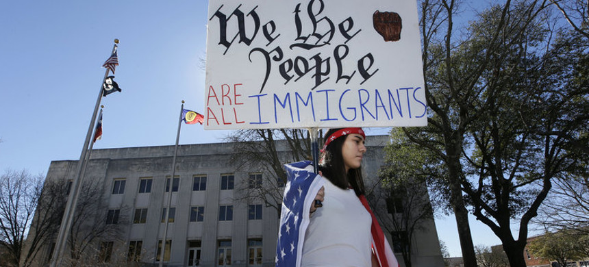 Observing a Day Without Immigrants, high school senior Vicky Sosa holds a sign outside the Grayson County courthouse in Sherman, Texas, Thursday. (photo: LM Otero/AP)