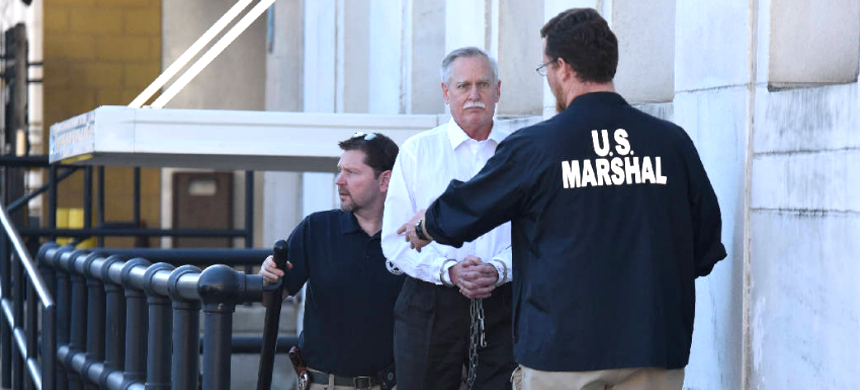 Former Tennessee Valley Authority engineer Robert Doggart is escorted from the Joel W. Solomon Federal Building in Chattanooga after his four count conviction of planning an attack on a Muslim community. (photo: Tim Barber/Times Free Press)