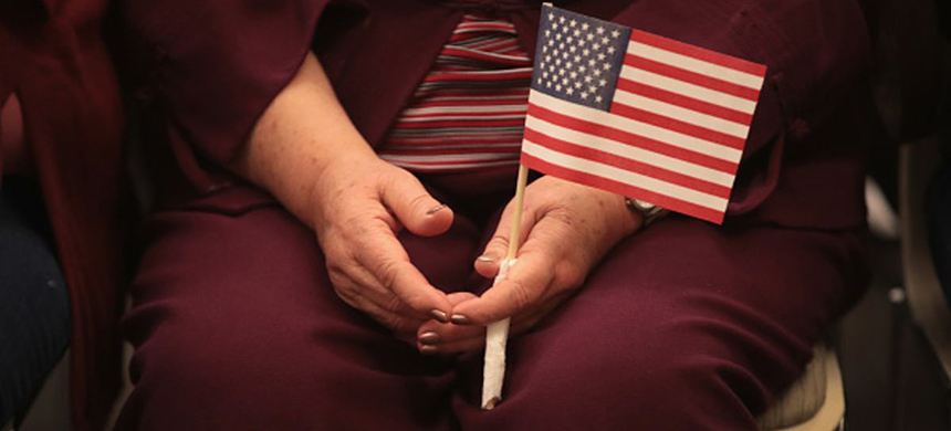 A woman sitting with an American flag in her lap. (photo: Scott Olson/Getty Images)