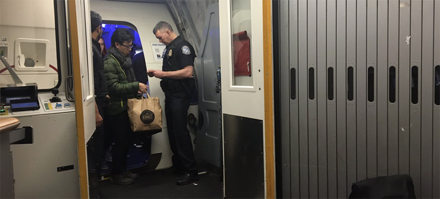 Passengers from SFO to JFK were told they couldn't disembark without showing CBP their 'documents.' (photo: Ann Garrett/Twitter)