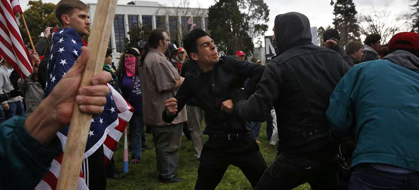A Trump supporter who preferred not to give his name trades blows with a masked anti-fascist protester during a pro-President Donald Trump rally and march at the Martin Luther Jr. Civic Center park March 4, 2017 in Berkeley, Calif. (photo: Leah Millis/The Chronicle)