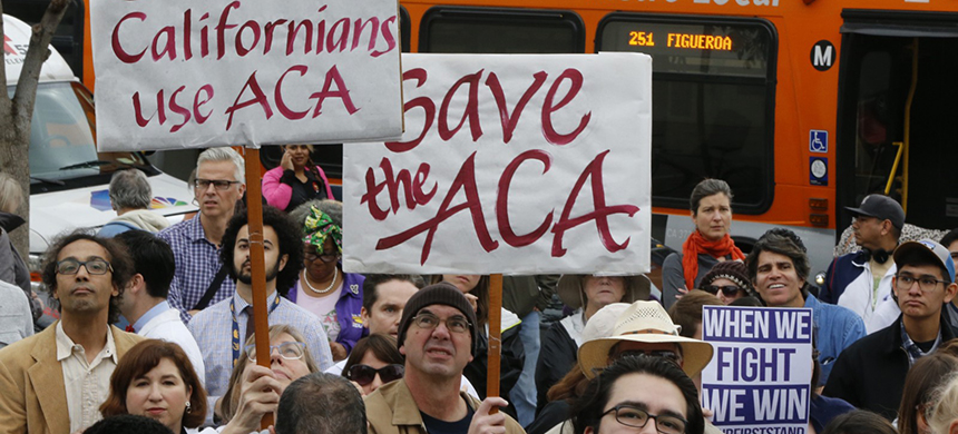 Californians rallied in January to save the Affordable Care Act. (photo: Damian Dovarganes/AP)