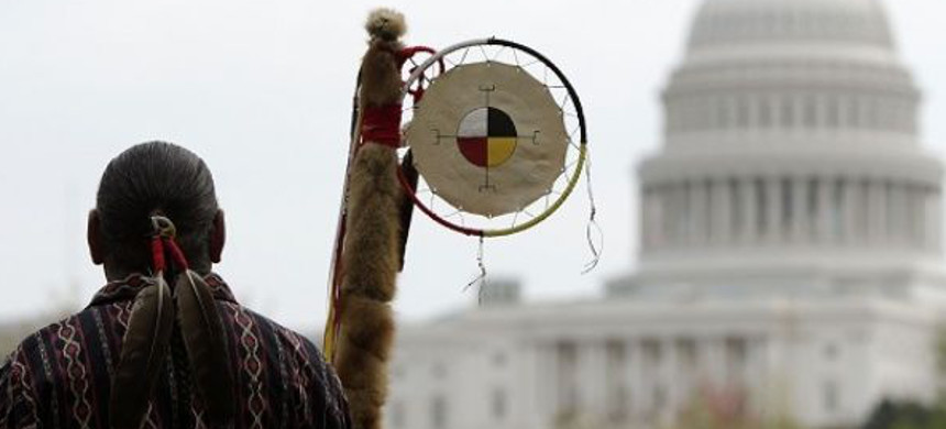 Matthew Black Eagle Man of the Sioux Long Plains First Nation protests in front of the U.S. Capitol against the Keystone XL pipeline in April 2014. (photo: Reuters)